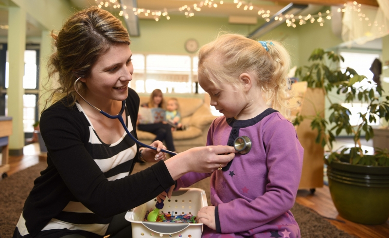 Nurse practitioner student Kristine Rowswellinteracts with a child at the UNBC ChilddcareCentre.
