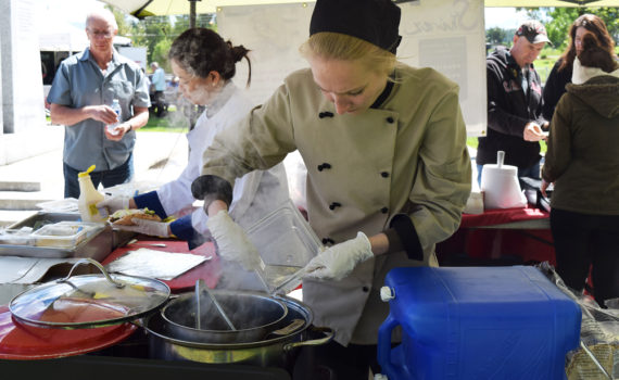 Getting the chicken shwarma just right at the Shiraz booth at Foodie Fridays. Bill Phillips photo