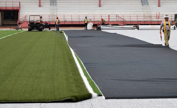 Workers install the new synthetic turf at Masich Place Stadium. Bill Phillips photo