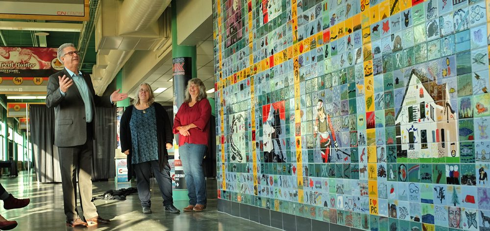 Mayor Lyn Hall with Karen Heathman and Joanne Mikkelsen of the PG Potters Guild taking in the Canada 150 Patchwork. City of Prince George photo