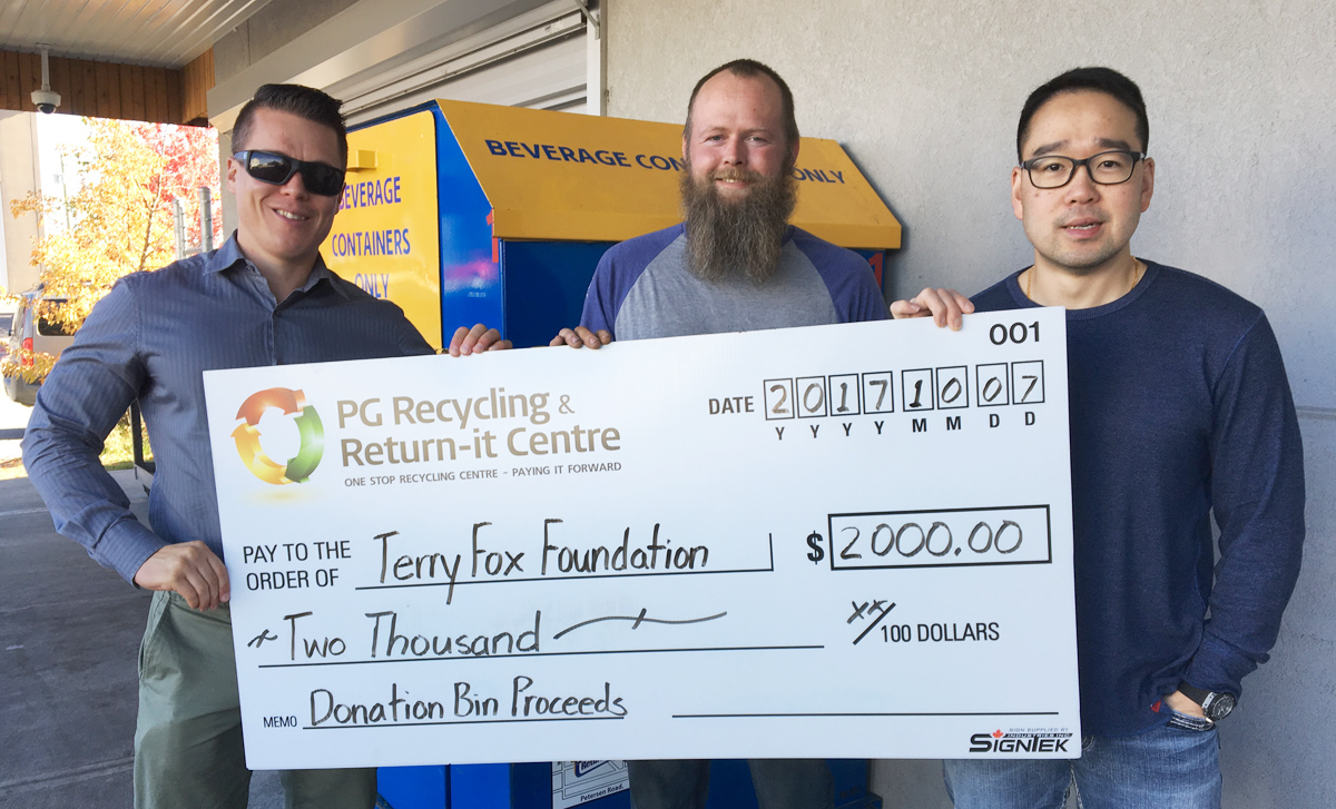 Local Terry Fox Run organizer Scott McWalter (left), accepts a $2,000 cheque from PG Recycling and Return-it Centre manager Ken Ziemer and owner Austin Kim. Bill Phillips photo