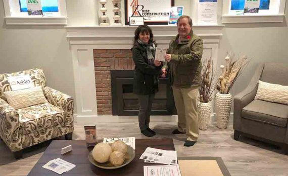 Last week, the PG Daily News ran a fun little contest for a FREE Prince George Hospice Society Dream Home ticket. Congratulations to Pamela Janet Boehmer, whose name was drawn as the lucky winner. Presenting her with the ticket PG Daily News publisher Bill Phillips. Good luck on the December 1 grand prize draw date. For anyone looking to purchase their Hospice Dream Home lottery tickets online, please visit the following link: http://bit.ly/2017DreamHomeTicket