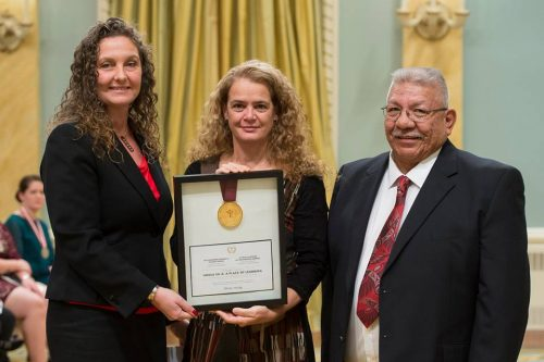 Frederick, Calogheros accept Governor General's award