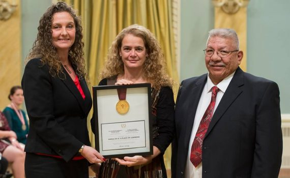 The Exploration Place CEO Tracy Calogheros (left) and Lheidli T'enneh Chief Dominick Frederick accept award from Governor General Julie Payette. Facebook photo