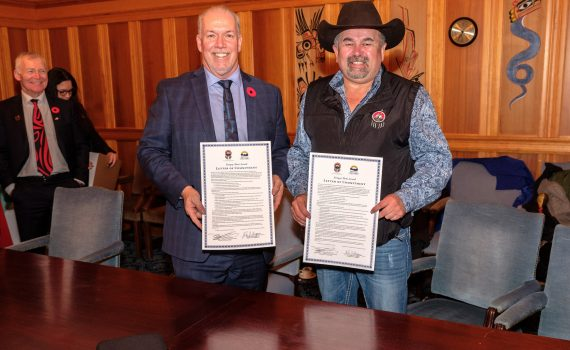 Premier John Horgan and Tsilqot'in Chief Joe Alphonse. Province of B.C. photo