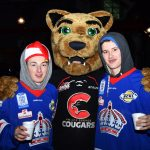 Rowdy Cat teams up with a couple members of the Prince George Spruce Kings at the Civic Light Up ceremony. Bill Phillips photo