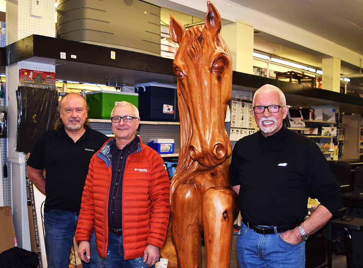 Elmer Gunderson, Blair Moffat of Northern Hardware, and John Brink with Gunderson's creation. Bill Phillips photo