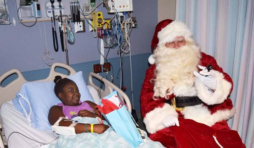 Santa makes a stop at UHNBC pediatrics ward