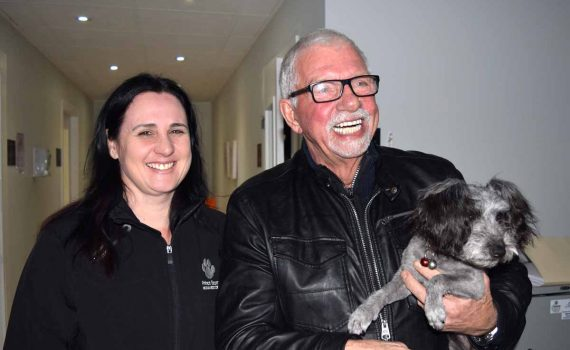 Angela McLaren of the Prince George Humane Society, John Brink of the Brink Group of Companies, and Bia, are thrilled with a $600 donation to the society. Bill Phillips photo
