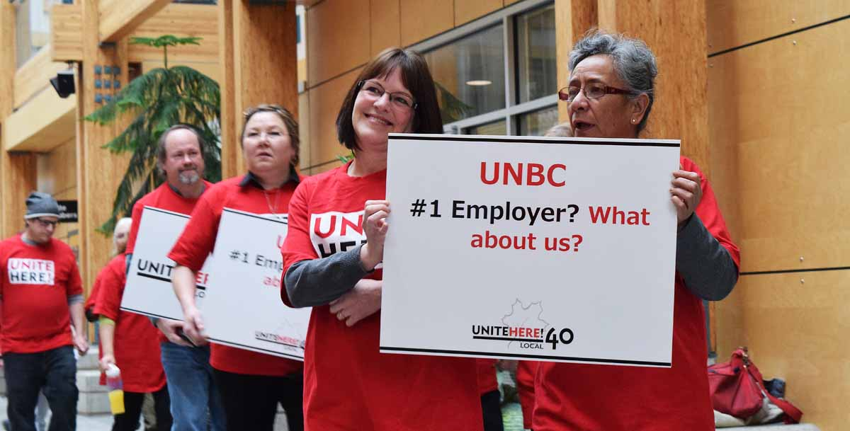 Unite Here Local 40 bargaining committee members Melody Danchuk and Jeannie Gilbert, shop steward, lead a rally in McCaffray Hall calling on UNBC to help food service workers get better pay from their employer, Compass Group. Bill Phillips photo