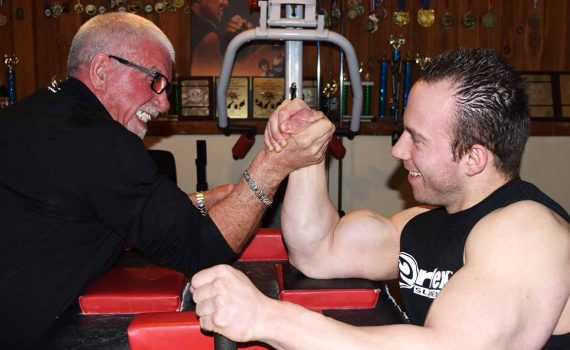 Eight-time national arm wrestling champion Dan Gallo twists wrists with John Brink, who is sponsoring him this year. Bill Phillips photo
