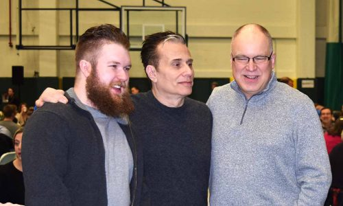 Michael Landesberg with Marcel Profit and his son at the Timberwolves Legacy Breakfast Monday. Bill Phillips photo