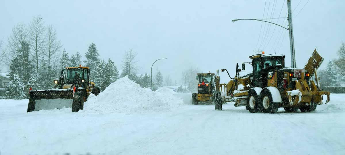 City graders and a front end loader were busy clearing Fifth Avenue Wednesday morning. Bill Phillips photo