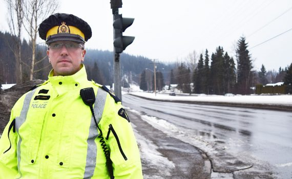 Sgt. Matt LaBelle of the Prince George RCMP's municipal traffic services section warns motorists to put their cellphones away. Bill Phillips photo