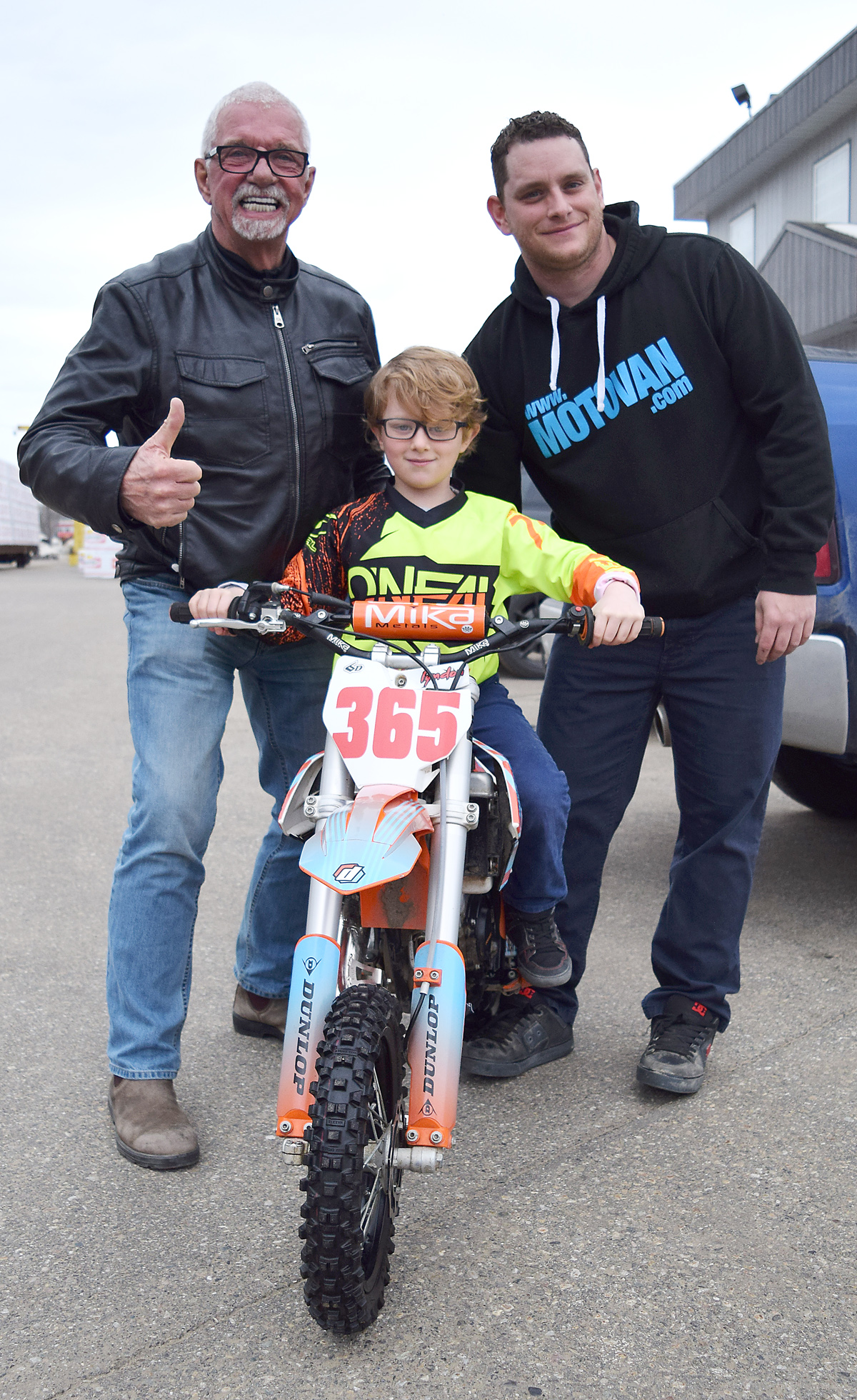 Motocross racer Lyndon Patenaude with his father Trevor (right) and one of his sponsors John Brink. Bill Phillips photo