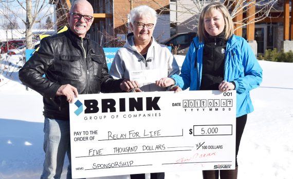John Brink, of the Brink Group of Companies, provides a $5,000 to this year's Relay for Life. Accepting the funds are Helen Owen and Aimee Cassie. Bill Phillips photo