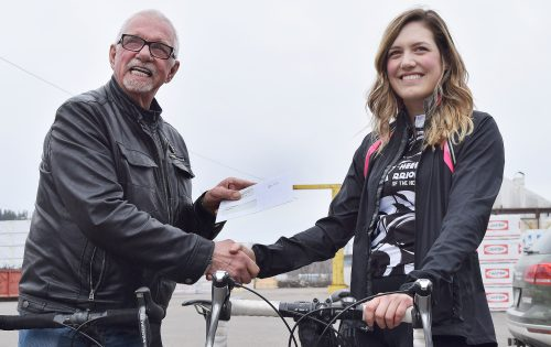 John Brink of the Brink Group of Companies presents Wheelin' Warriors of the North rider Haylee Seiter with a $500 sponsorship. Bill Phillips photo