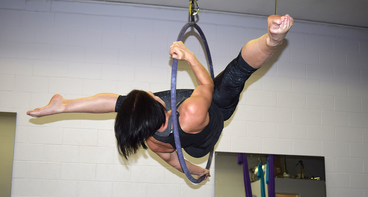 Angel Stewart goes through one of her hoop routines at Angel's Aerial Fitness on First Avenue. Bill Phillips photo