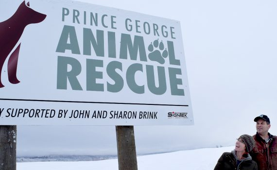Nicola Redpath and Grant Stubley admire the new sign for the newly-named Prince George Animal Rescue. The society was formerly called Prince George Equine and Animal Rescue. Bill Phillips photo