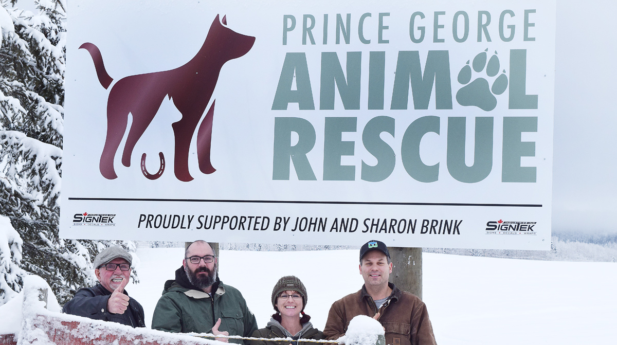 John Brink, of the Brink Group of Companies, Luc Michaud of Signtek, and Nicola Redpath and Grant Stubley of Prince George Animal Rescue unveil the new sign at the society's Bendixson Road location. Bill Phillips photo