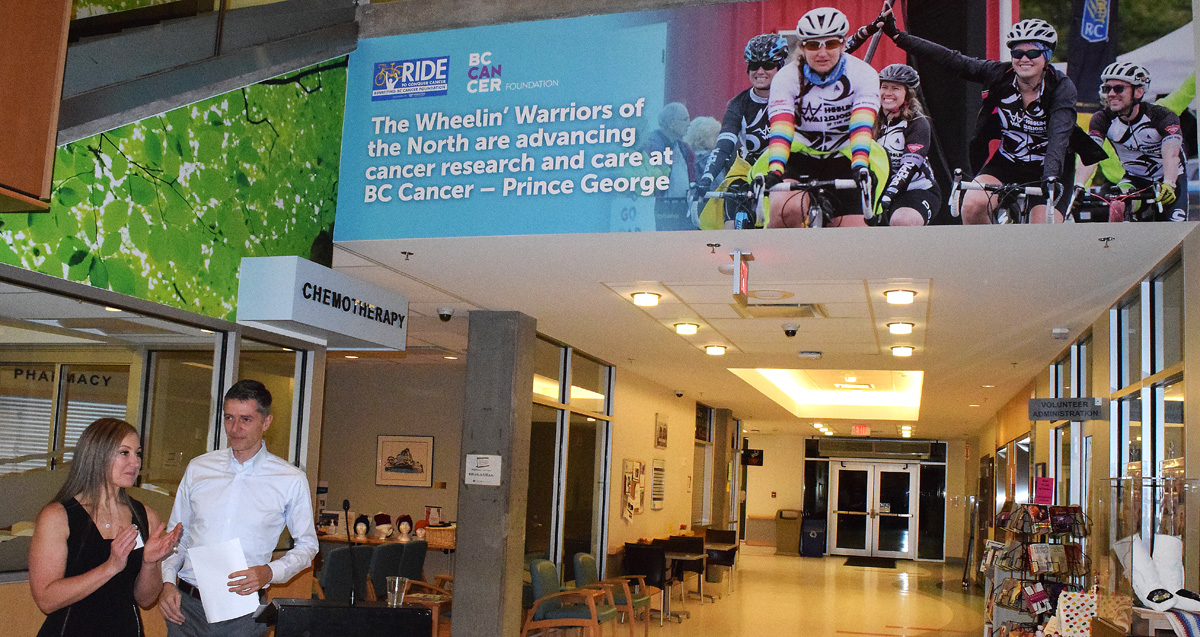 Karin PIche, co-captain of the Wheelin' Warriors of the North, and Lindsay Carswell, Director of the Ride to Conquer Cancer unveil a permanent fixture at the B.C. Cancer Centre of the North, recognizing the Wheelin' Warriors. Bill Phillips photo