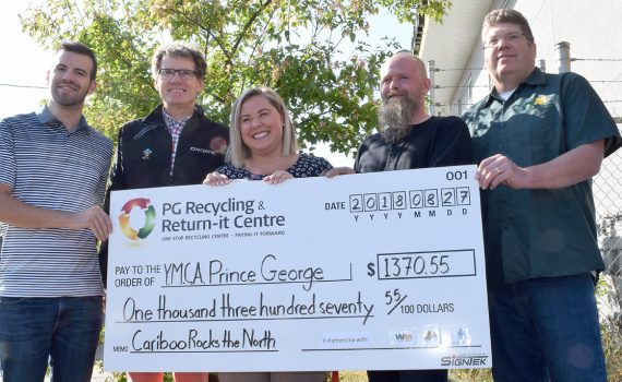 So what happened with all those empties at Cariboo Rocks the North? Waste Management was in charge of, well, managing the waste at the event and when they heard of the PG Recycling and Return-It Centre's ongoing program of donation bins where resident drop off their empties and the proceeds will go to a local charity, they jumped on it. The charity benefiting from the bins at Cariboo Rocks the North was the YMCA of Northern BC and a cheque for $1,370.55 was handed over Monday. On hand for the presentation are Cariboo Rocks the North organizer Kyle Sampson of Pacific Western Brewing, Glen Mikkelsen of CN Centre, Stephanie Mikalishen-Deol of the YMCA of Northern BC, Ken Ziemer of the Return-It Centre, and Scott Dobie of Waste Management. Bill Phillips photo