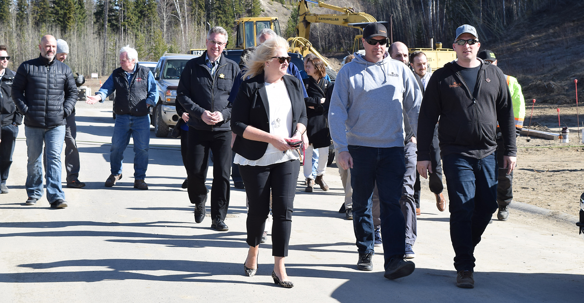 Jeff Stewart, Brent Scheck, of Copper Falls Custom Homes, Judy Neiser of Spirit of the North Healthcare Foundation, and several contractors check out a home on Links Drive that will sold with the proceeds going to Spirit of the North. Bill Phillips photo