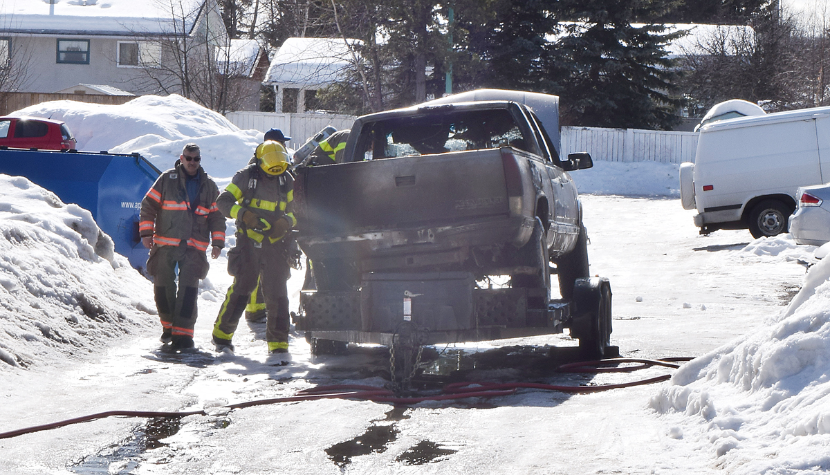 Prince George Fire Rescue Services deal with a vehicle fire just off First Avenue near Ospika Boulevard. The truck was apparently being towed on on a trailer when it caught fire. Cause of the fire has not yet been released. Bill Phillips photo