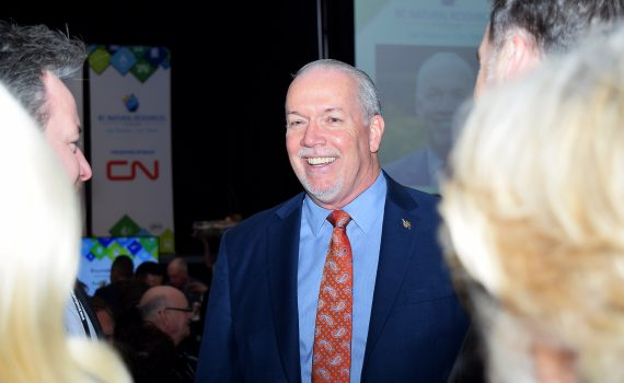 Premier John Horgan greets delegates at the BC Natural Resources Forum in Prince George Wednesday. Bill Phillips photo