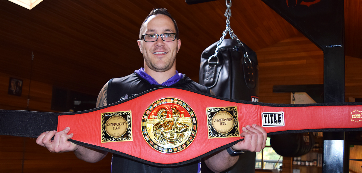 Jason Keller shows off one of the championship belts up for grabs at Fitness for Alzheimer's, set for October 21 at the Healthier You Expo. Bill Phillips photo