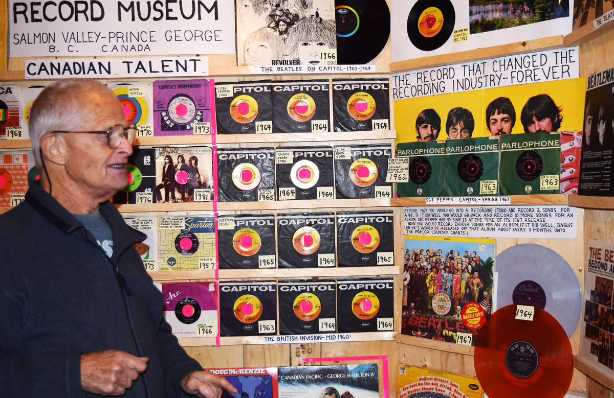 Jim Good showing of original Beatles 45s in his music museum.