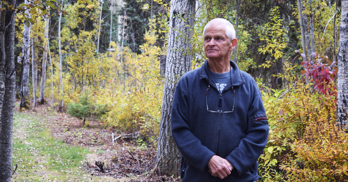 Jim Good walks along one of the trails of Goodsir Nature Park in Salmon Valley. Good built the park himself. Bill Phillips photo