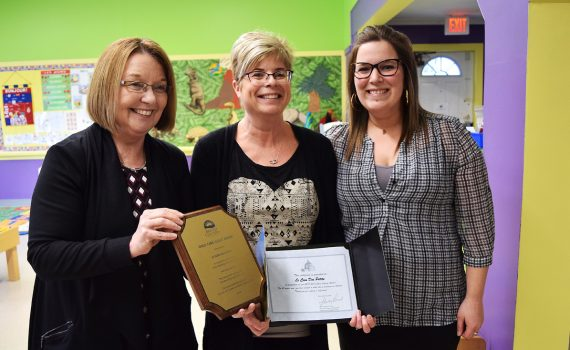 Prince George-Valemount MLA Shirley Bond presents a Child Care Legacy Award to Chantal Marquis, early childhood educator, and Martine Belanger, executive director of Le Coin des Petits. Bill Phillips photo