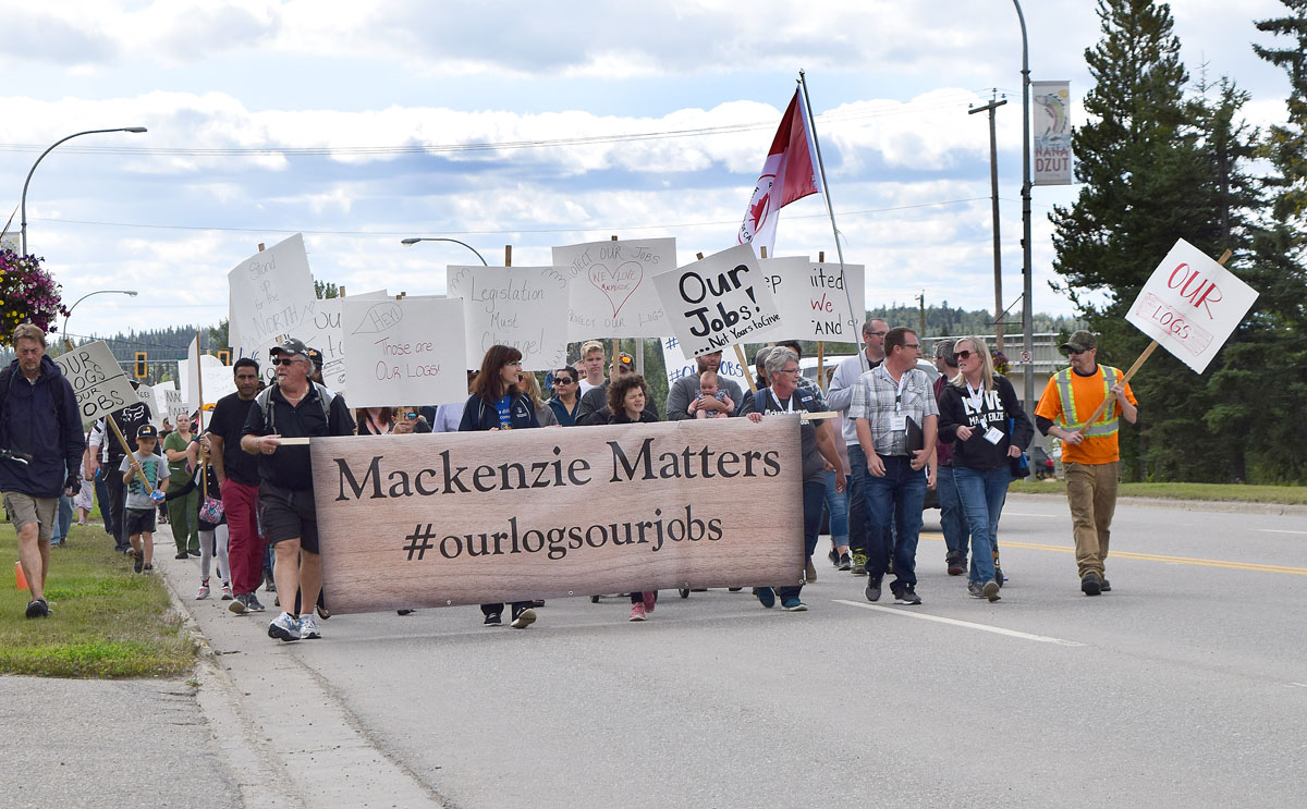 """Close to 1,000 people marched through the streets of Mackenzie and then attended a two-hour rally in support of the forest industry in the region. Organized my #MackenzieMatters the slogan of the day was """"Our logs, Our jobs,"""" which is a call for timber harvested in the region to be processes in the region. Bill Phillips photo"""