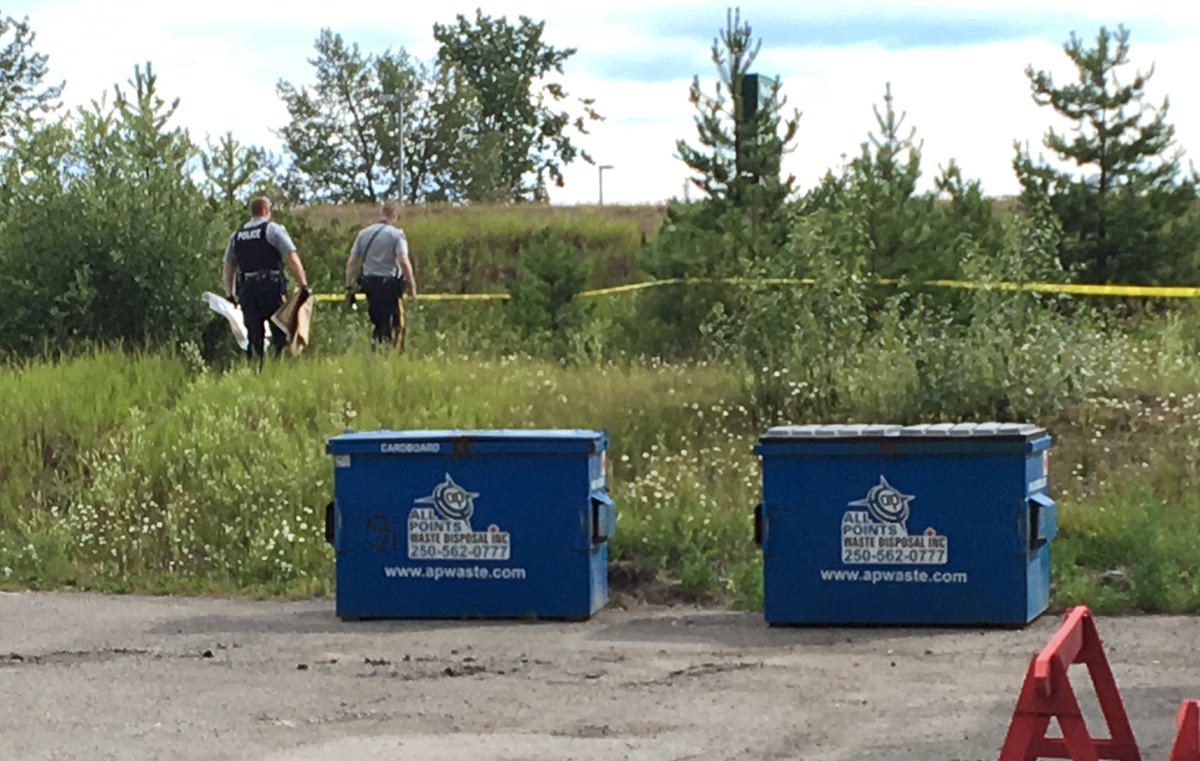 RCMP officers collect evidence at the scene of an early morning motorcycle crash on Highway 97 near Westwood Drive near the entrance to Pine Centre Mall. RCMP Cpl. Craig Douglass said there were injuries in the crash and more details will be released later this morning. Bill Phillips photo
