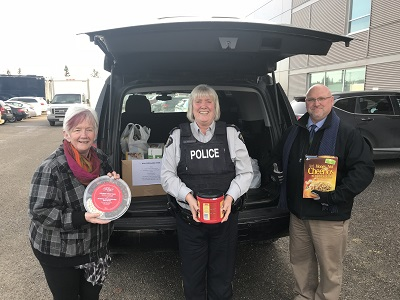 North District RCMP employees delivered numerous bags of groceries and various gift cards for local grocery stores to the Prince George Counsel of Seniors today.During this busy time of year, Santa recruited some help and called upon Sgt. Kevin Podbisky, Cpl. Madonna Saunderson and public servant Judy Fowlie, to assist with the pre-Christmas delivery. RCMP photo