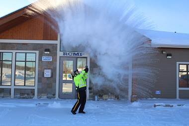 "When the mercury dips to -35 and colder, often we opt for the warmth of the ""great indoors"" waiting anxiously await the arrival of spring. In Fraser Lake, the RCMP embrace all that Mother Nature brings and head outside for a little fun experiment. Boiling water plus frigid temperature equals ice crystals. RCMP photo"