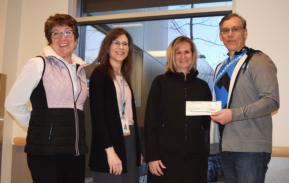 Ron Gallo presents a cheque for $9,320 to Terry Zanette, who won the Conquer Cancer 50/50 draw. He also presented $10,390 to Dr. Stacy Miller and Kathy Giene of the B.C. Cancer Foundation. Bill Phillips photo