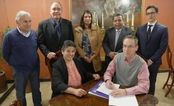 Canada Research Chair in Hybrid Wood Structures Engineering Dr. Thomas Tannert (front, right) signs an agreement with Faculty of Engineering at the University Santiago de Chile. The two institutions pledge to work together in research and teaching. UNBC photo