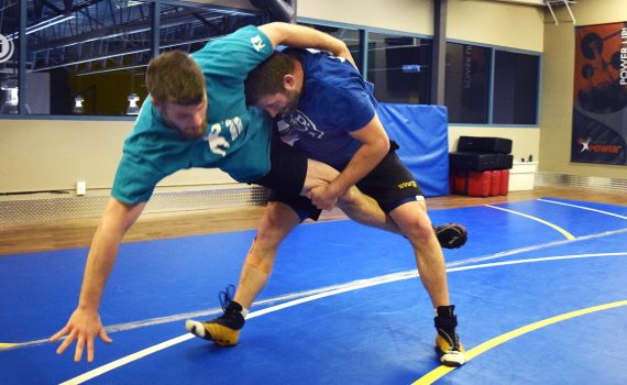 Wrestler Ben Dyck tosses his brother Dan to the mat as the two train for a tournament in Calgary this fall. Bill Phillips photo