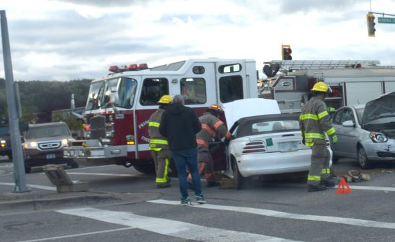 Emergency crews attend the scene of a two-car crash in the intersection of Ospika Boulevard and Fifth Avenue shortly before 6 p.m. Wednesday. There appeared to be some minor injuries. Bill Phillips photo