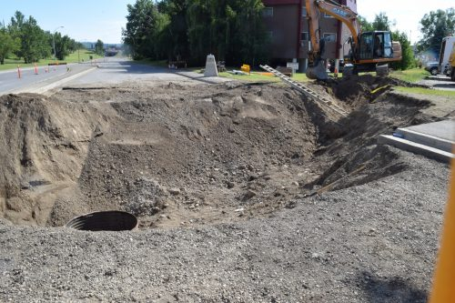 City installing temporary dam to help determine and repair cause of sinkhole