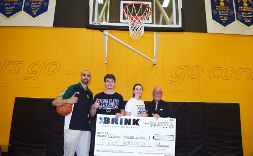 PG Summer Hoops Classic organizer Nav Parmar and players Garet Anderson and Rebecca Landry accept a $500 donation for the three-on-three basketball tournament June 9.