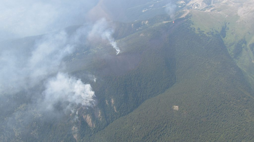 The McKirdy Mountain fire is 35 hectares in size is and is burning two kilometres east of Valemount. Fifteen firefighters are currently working on the southern flank of the fire to ensure that the fire does not grow towards the village of Valemount. The fire is not exhibiting any growth. The majority of the fire is on the other side of the ridge and burning away from town. Crews are continuing to create guard and get hose lay to the northwest flank of the fire. Cooler temperatures and some precipitation have helped with suppression efforts. BC Wildfire Service photo   This fire is not currently threatening the Village of Valemount.