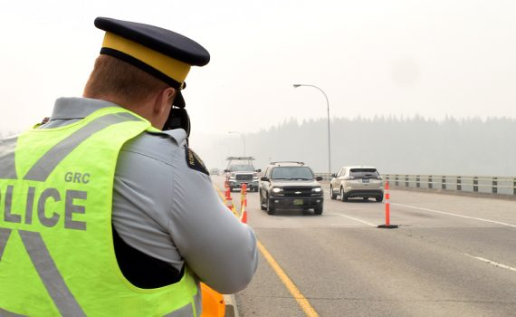 RCMP officers check for speeders on the Yellowhead Bridge on Highway 16 east of the city. Bill Phillips photo