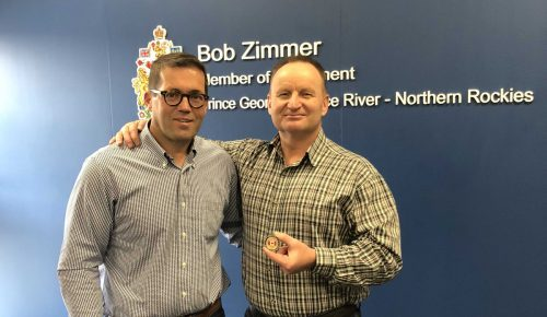 Prince George-Peace River-Northern Rockies MP Bob Zimmer presents a challenge coin to Safeguard owner Jeff Kelly in recognition of his efforts to help fight B.C. wildfires.