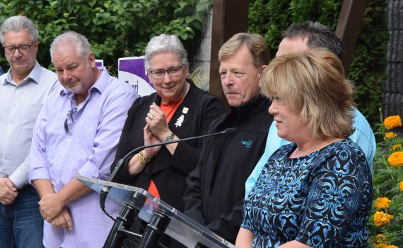 Terri McConnachie, (right) flanked by Mayor Lyn Hall, her husband Kevin McConnachie, and councillors Susan Scott, Murry Krause, Brian Skakun and (not pictured) Garth Frizzell and Frank Everitt, announces her intention to seek a second term on city council. Bill Phillips photo