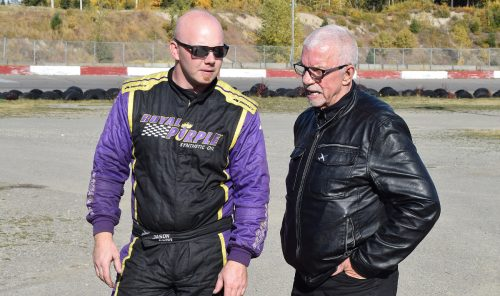 Jason Conn gives John Brink, Founder and CEO of the Brink Group, a demonstration of his sprint car. Bill Phillips photo