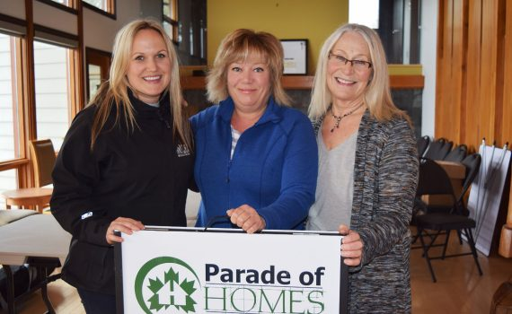 Christina Klotz (left), of the Independent Contractors and Businesses Association, and Terri McConnachie and Marilyn Greenwood of the Canadian Home Builders Association get ready for the Parade of Homes this Sunday. Bill Phillips photo