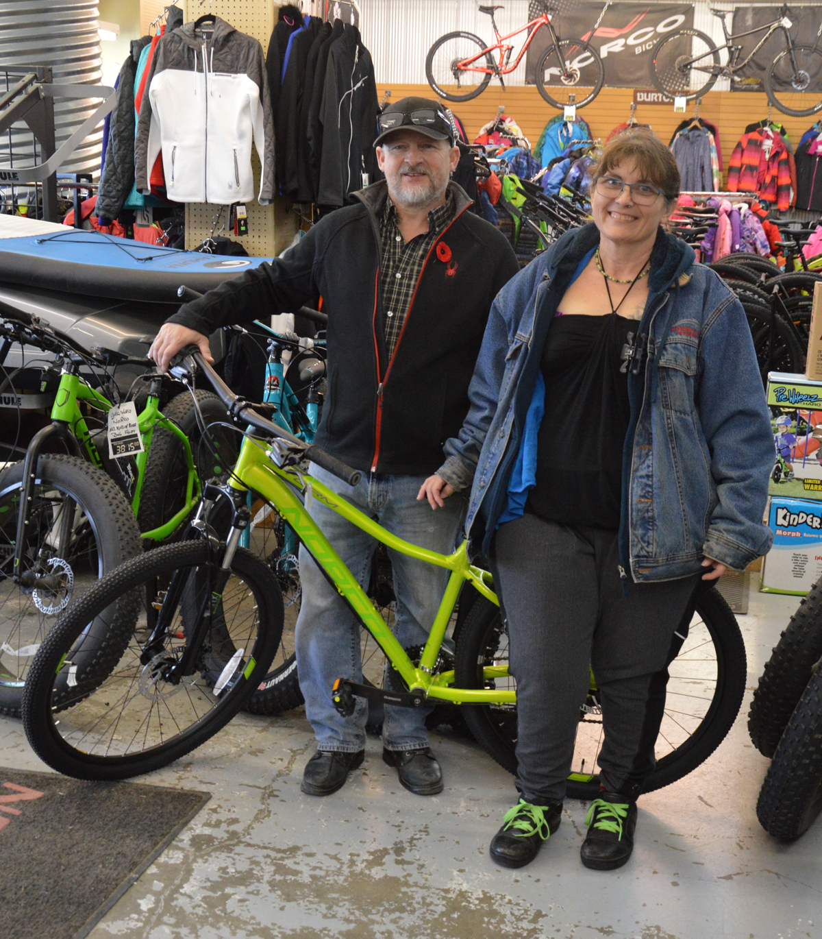 John from Cycle World presents Lorrie Taylor with the Norco Storm mountain bike. RCMP Photo